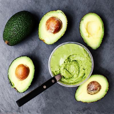 Halved avocado.  spread.  pasta. Guacam