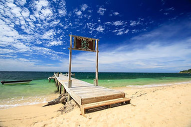 camp bay lodge dock sign on beach.jpg