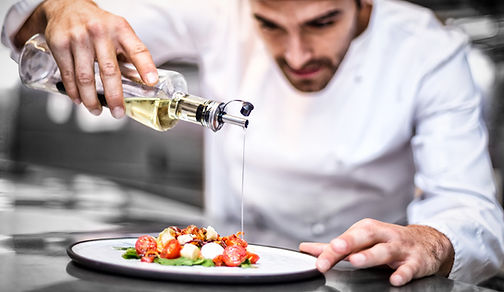 chef pouring olive oil Italy