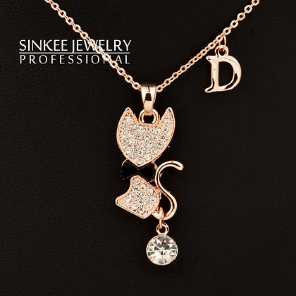 Crystal Filled Rose Gold Cat w Black Bow