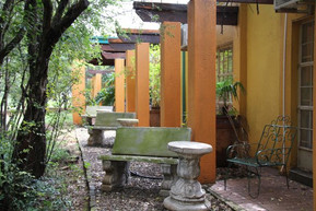 The room opens up on a small patio overlooking the riverine forest.