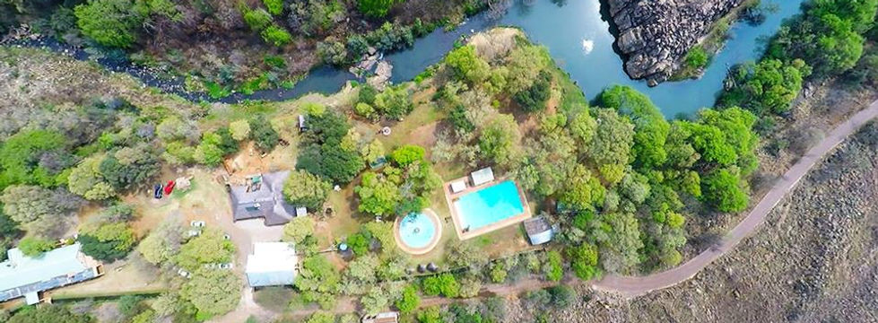 Aerial view of one of the most beautiful river front properties in Magaliesburg, Gauteng South Africa. Enjoy fishing or camping in the ravine forest, or just enjoy our four star Lodge, self-catering cottage or restaurant.