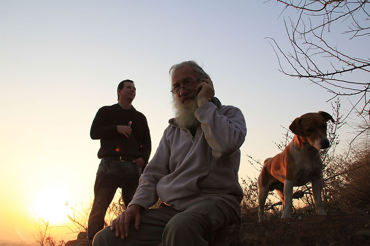 Late Robin Walton and Cobie Els enjoys a walk up the mountain with one of the Hornbill pack Jack Russels