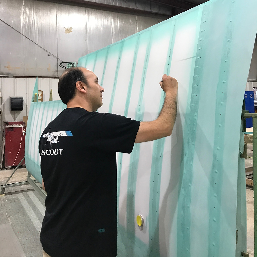 Adam working on wing fabric at American Champion Aircraft