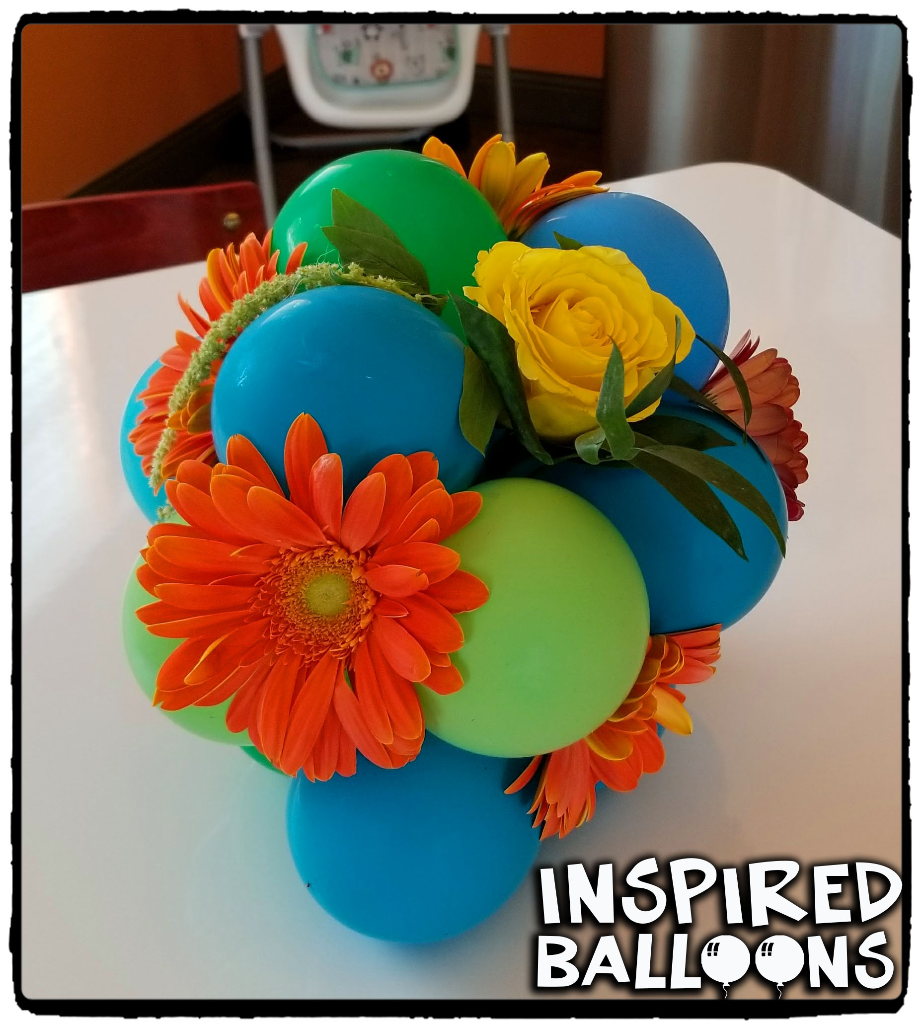 Balloons & Flowers Table Centerpieces Logo
