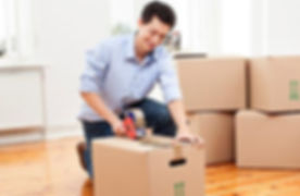 sfr young-man-taping-packed-boxes-for-moving_573x300.jpg