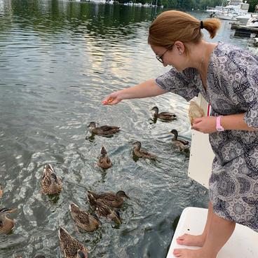 Air BnB Guest feeding the ducks