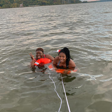 Smiles after finally getting the courage to jump off the boat and into refreshing water!