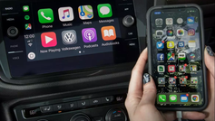 """Are you looking to retrofit Apple CarPlay into your vehicle? If you've recently driven a rental car or service loaner vehicle, chances are it was equipped with Apple CarPlay. Apple CarPlay provides safe and convenient access to various music apps, podcasts, GPS navigation and text messages while driving. It's the kind of technology you never realized you needed until you experienced it. If you've had the chance to use this convenient technology, you may be wondering if it can be added to your vehicle. Don't trade your car in for a newer model just yet – in many cases Apple CarPlay can be easily retrofitted. How to Retrofit Apple CarPlay to your car There are various aftermarket companies that manufacture Apple CarPlay Retrofit kits. If your vehicle has an AUX input and a multimedia interface, commonly referred to as """"MMI"""", chances are there is an Apple CarPlay retrofit kit available. Retrofit Apple CarPlay using an AUX input How do you get Apple CarPlay through your vehicle's AUX input? In order to retrofit Apple CarPlay, engineers have developed hardware designed to piggyback off your existing infotainment system. These plug-and-play modules, available from premium suppliers such as ZZ-2, Grom Audio and BimmerTech, enable Apple CarPlay to function through your factory radio. Users first select """"AUX input"""" as their media source on their infotainment system. The next step is to simply press and hold a designated button on the MMI controls (typically the """"Menu"""" button) to launch Apple CarPlay. Once Apple CarPlay is activated, users can use their existing MMI controls to scroll through their various apps and make selections on screen. One thing to keep in mind: because Apple CarPlay is functioning through the AUX input source, the features of Apple CarPlay – such as GPS directions and text notifications – are only functional when you are actively using Apple CarPlay. If you are listening to another audio source such as SiriusXM for example, you will not hear GPS direct"""