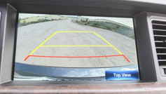 """Adding a rear-view camera to your vehicle is a great way to increase driver visibility and improve vehicle safety. According to NHTSA, every year, over 180 fatalities are attributed to back-over accidents. On top of that, each year there are approximately 7,000 injuries that occur from back-over related crashes. Although the federal government has mandated that all new vehicles manufactured after May 1st, 2018 be equipped with a rear-view camera as standard safety equipment, there are millions of vehicles on the road that were built prior to this. Many of them lack this standard safety feature. If you drive one of those vehicles you may be wondering if it's possible to add a rear-view camera to your car. How to add a Rear-View Camera Adding a rear-view camera to your vehicle can improve driver visibility and vehicle safety. One of the easiest and most cost-effective methods to do this involves replacing your rear-view mirror. Quality aftermarket rear-view mirrors are available with an embedded rear-view camera monitor. This monitor is typically 4.3"""" wide diagonally and encompasses about ½ the size of the mirror. It is automatically activated when your vehicle is shifted into reverse. An accompanying back-up camera is installed and wired to the monitor to provide you with a clear view of what is directly behind your vehicle. Alternatively, you may also be able to add a rear-view camera to your vehicle using an aftermarket car stereo. If your current car stereo is lacking in modern features like Bluetooth, updating it to one that supports Apple CarPlay or Android Auto in addition to adding a reverse camera may be the best option for you. Retrofit a Rear-View Camera to your Infotainment Monitor Looking for a solution that looks more like original manufacturer equipment? Depending on the year, make and model of your vehicle, it may be possible to retrofit a back-up camera to your vehicle's native infotainment display. Specialty manufacturers such as PAC Audio, NAV-TV an"""