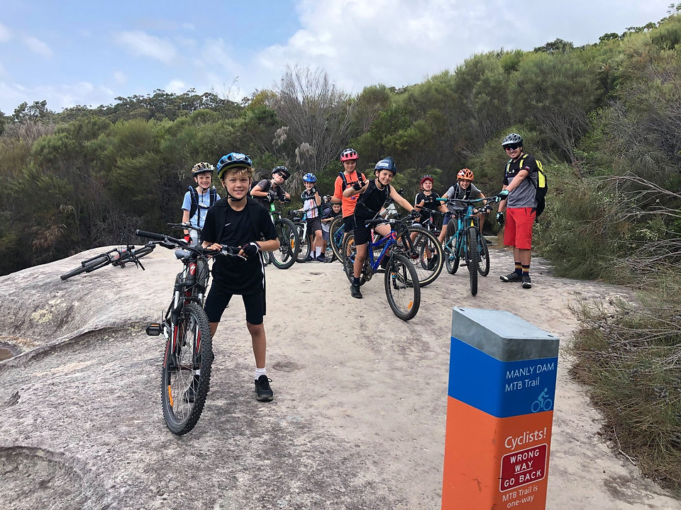 Group of young riders in a mountain bike clinic for kids at Manly Dam