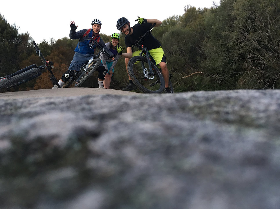 Group of mountain bikers having fun on a trail ride