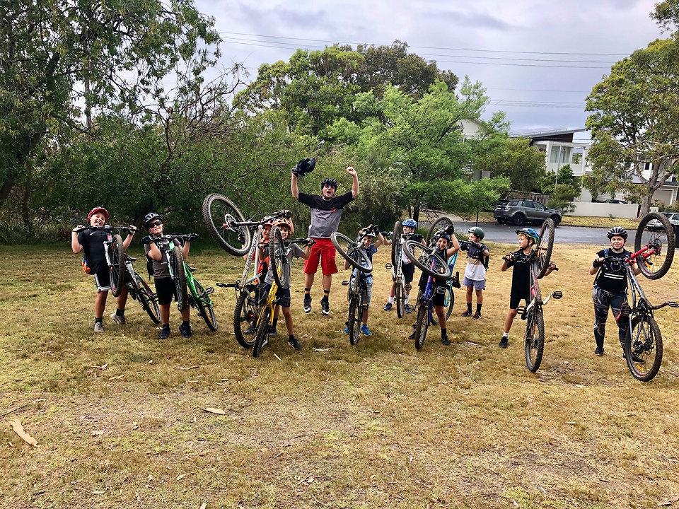 group of kids mountain biking
