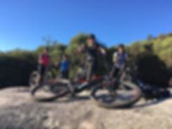 Group of female mountain bikers smiling