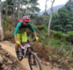 Chocolate Foot mountain bike skills coach Joe Ward riding singletrack in Derby Tasmania
