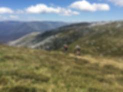 Mountain Bikers on a mountain ridge in Australia