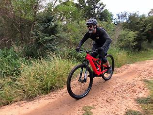 man riding e-mountain bike.jpg