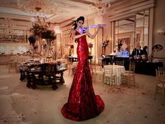AAE Stilt Walking Violinist red dress.jp