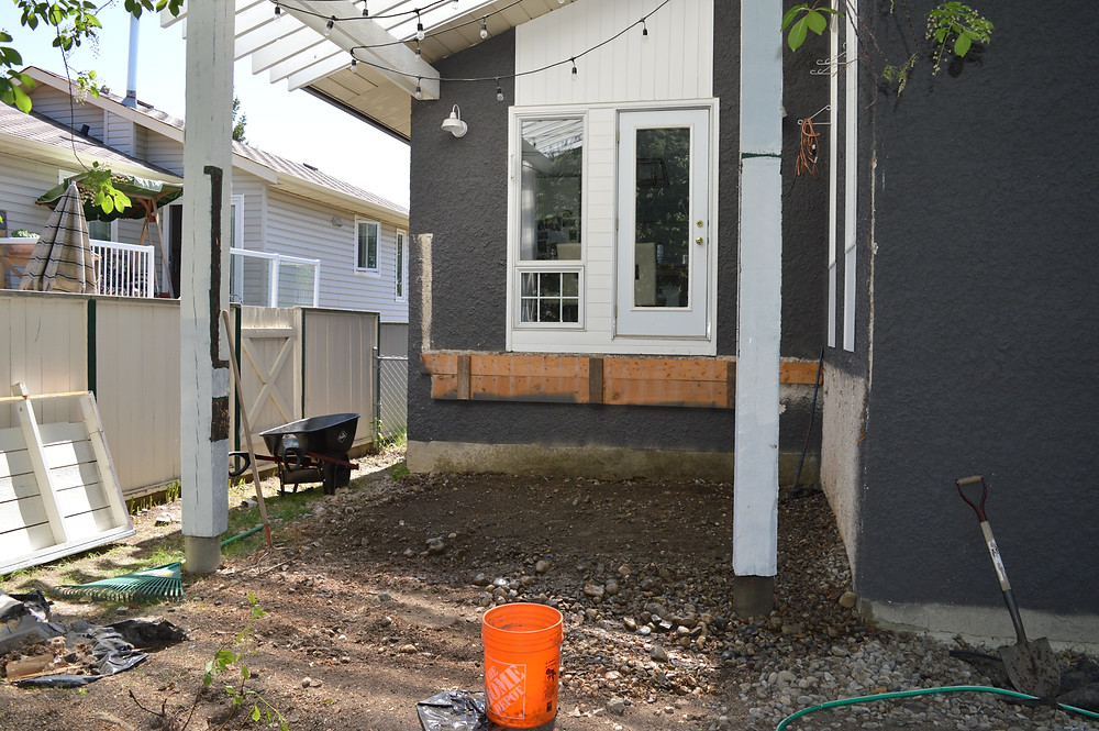 Regrading under a deck for proper drainage