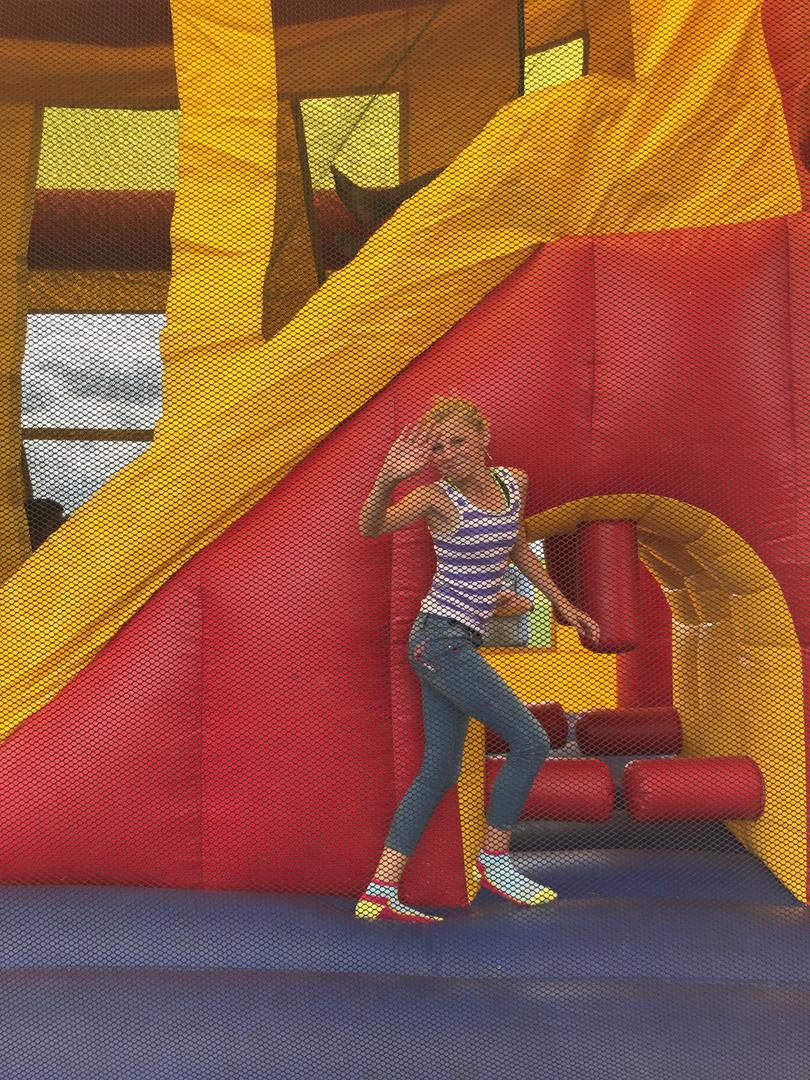 Kids having fun in the bounce house fun