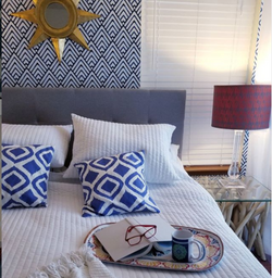 Blue Wallpaper and Prism Pillow Bedroom