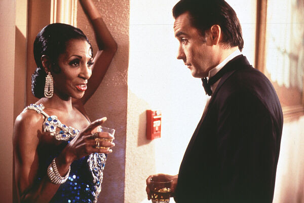 The Lady Chablis as herself in Midnight in the Garden of Good and Evil. John Cusack as John Kelso.