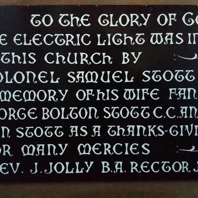 A memorial plaque regarding the installation of electric lights
