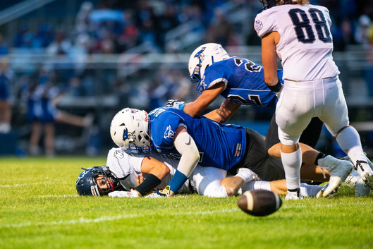 Yale quarterback Jacob Craig (bottom) loses the football after being sacked by Cros-Lex's Tyler Black during their game Friday, Sept. 6, 2019, at Cros-Lex High School.  Taken on assignment for the Times Herald, September 2019.