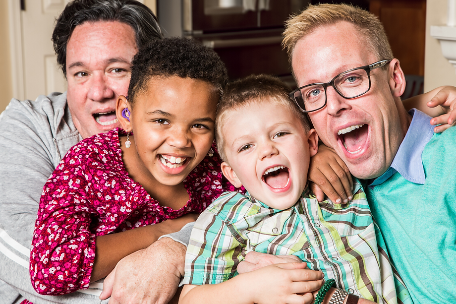 gay dads enjoying spending time with surrogate children