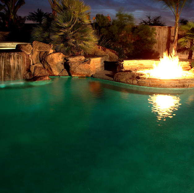 Custom pools with waterfalls, grottos, cabanas, and firepits