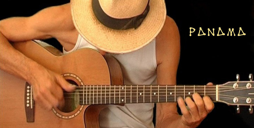 Panama Dave plays acoustic guitar