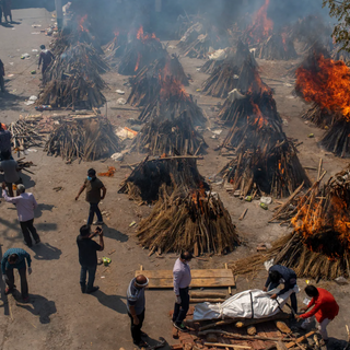 Funeral pyres in Delhi. There have been 21 million cases of COVID reported in the country, and over 213,000 deaths. The toll is considered to be much higher, as public health officials advise that many of the sick never make it to the overburdened hospitals and die at home.