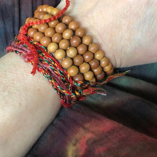 The pure sandalwood beads emit their unforgettable fragrance when worn and turned in prayer.
