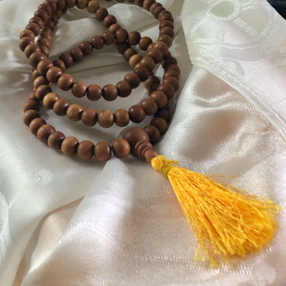 The sandalwood mala has 108 beads and a beautiful gold tassel.