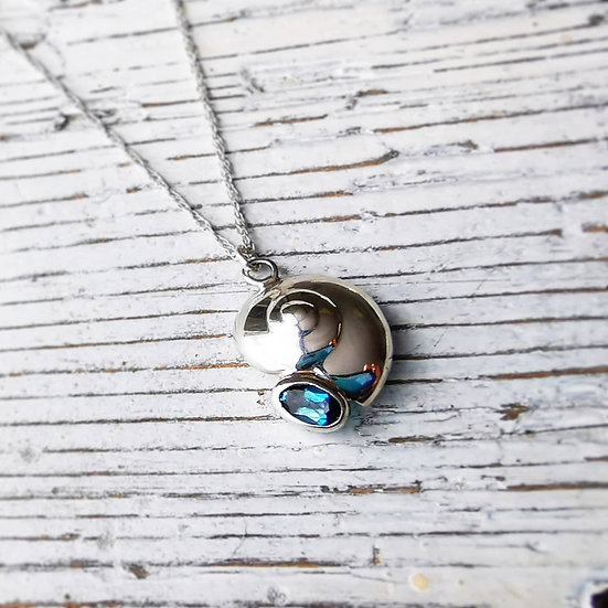 Sterling silver spiral shell with blue topaz detaiL