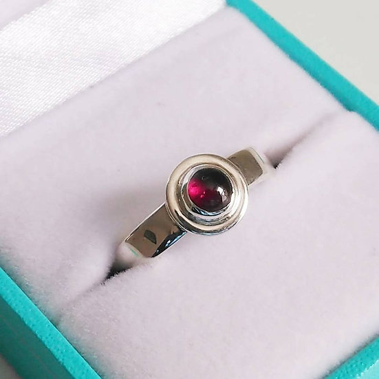 Sterling Silver Ring With Small Red Garnet