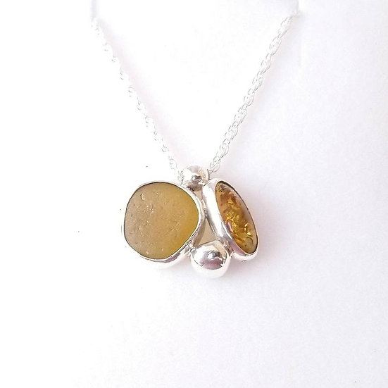 Sterling silver yellow seaglass pendant with amber