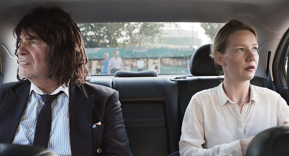 A still from Toni Erdmann - both lead actors in the car looking in opposite directions