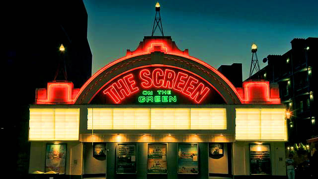 A photograph of Screen on the Green cinema in neon lights at night