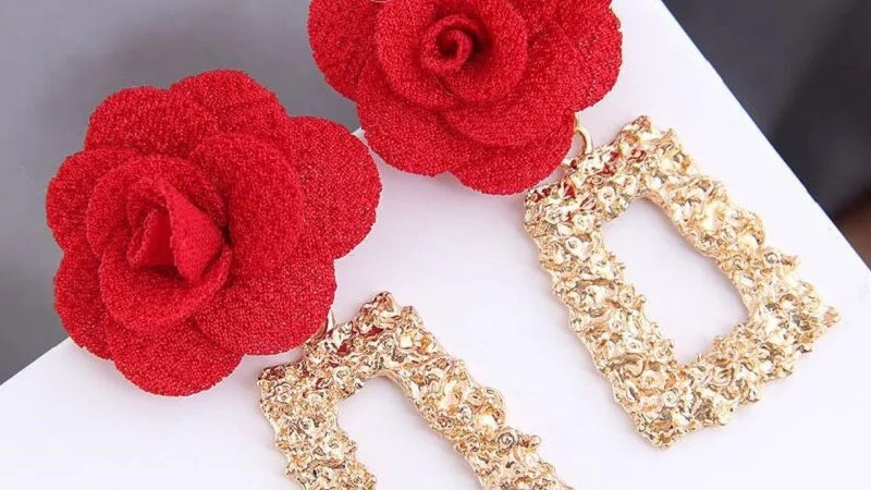 Red rose with gold earrings