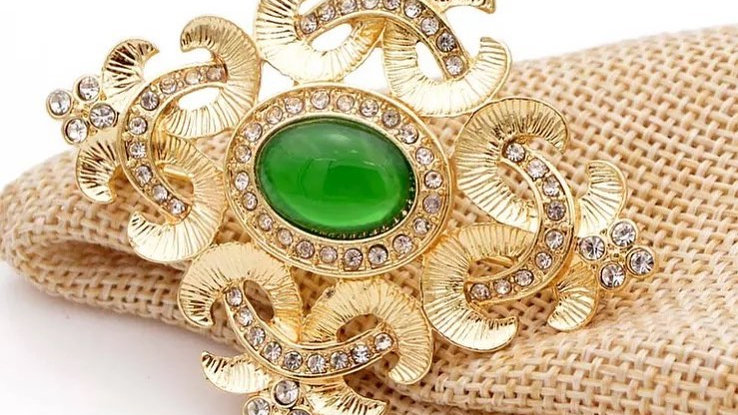 green and gold brooch