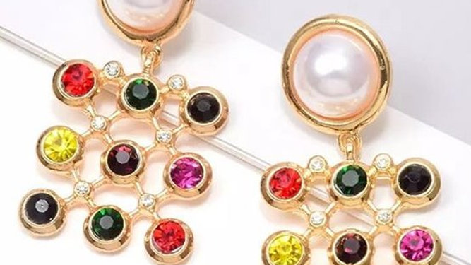 Pearl with multicoloured diamonte stones