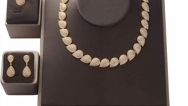 Gold with diamonte silver necklace set