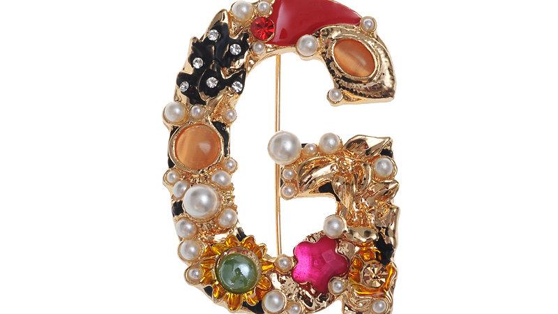 Gold multicolured brooch