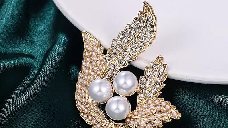 Gold with silver rhinestone  brooch
