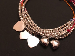 Flat and bulbous heart charms
