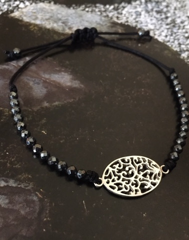 The Hematite string bracelet with the Oval Filigree charm