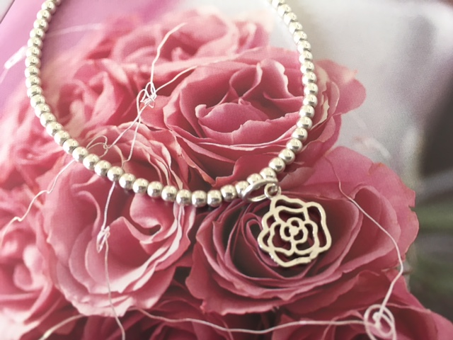 The lovely rose charm