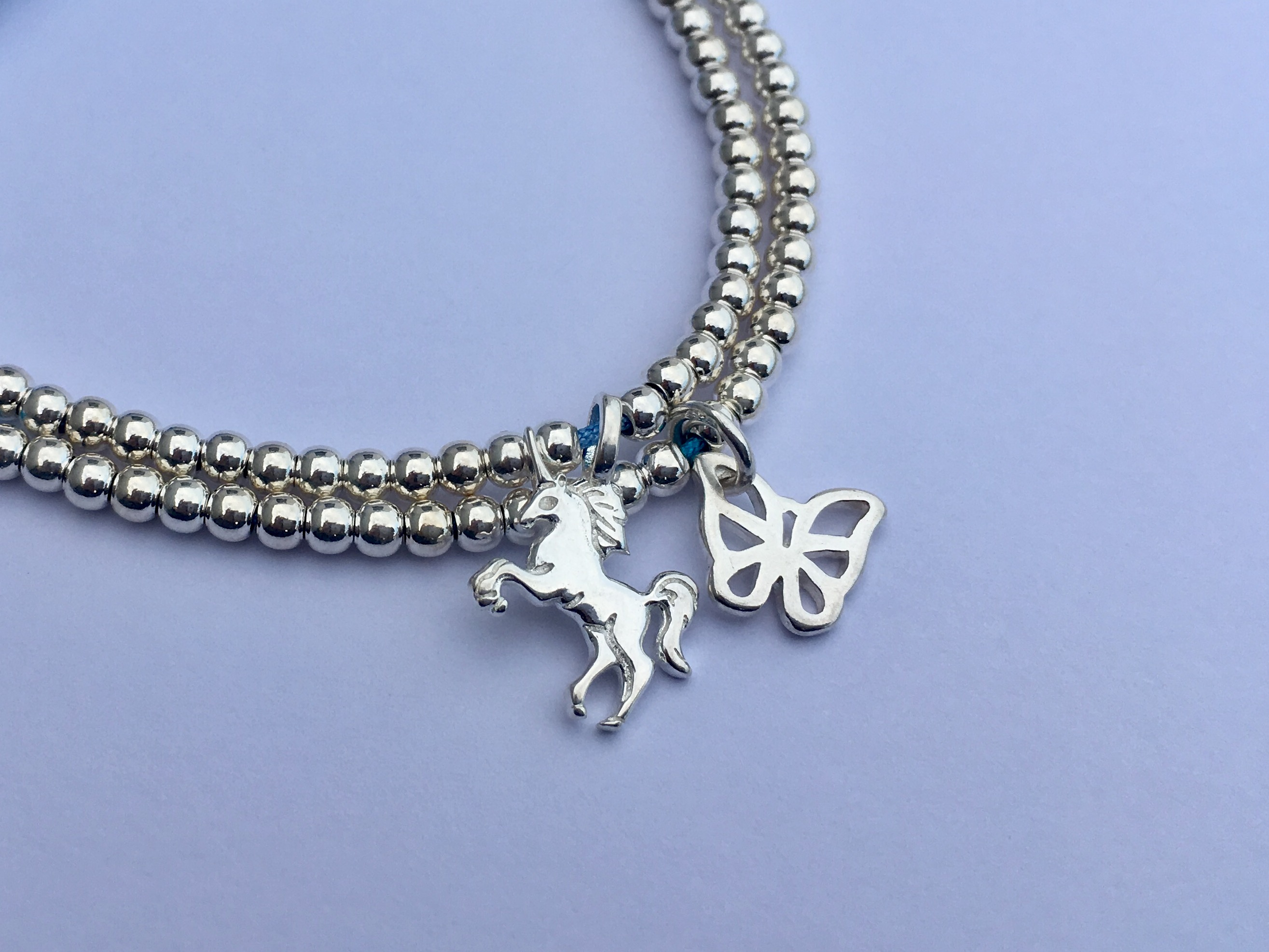 Butterfly and Unicorn charms