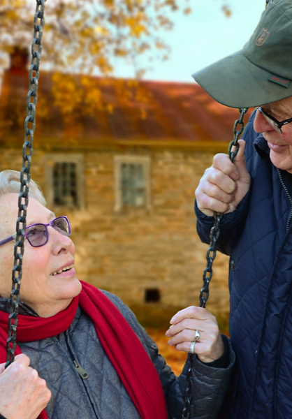 Old couple wife on swing.PNG